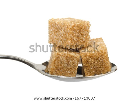 Three brown sugar cubes on spoon isolated on white - stock photo