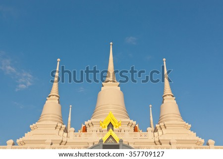 Three Buddhist temple pagoda under blue sky - stock photo