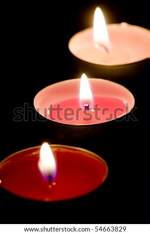 Three burning candles - stock photo