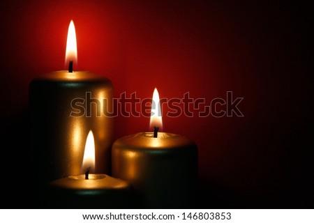 Three burning gold candle - stock photo