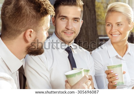 Three Business Colleagues Outdoors - stock photo