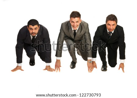 Three business men in a line being ready for start isolated on white background - stock photo