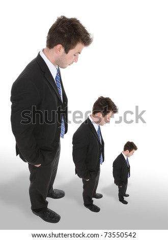 Three business men looking down as they get smaller - stock photo