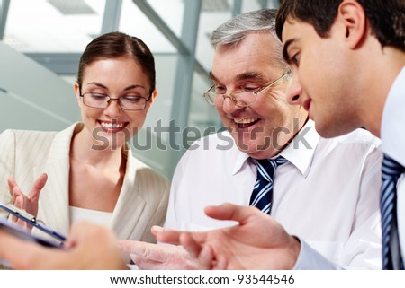 Three business partners sitting in office and planning work - stock photo