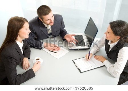 Three business people creating a business plan - stock photo