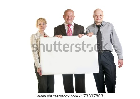 Three business people holding a banner - stock photo
