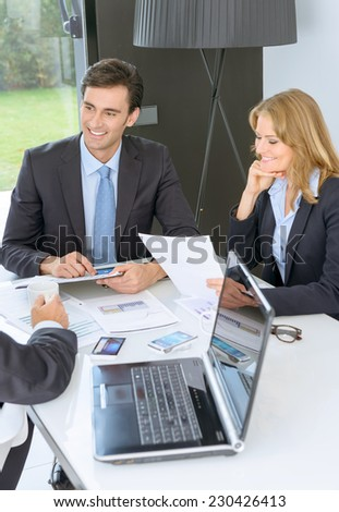 Three business people on a meeting - stock photo