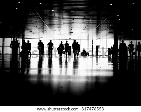 Three business people walking down the street talking. Silhouettes. - stock photo