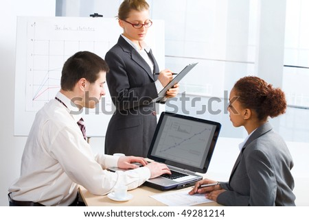 Three business people working together. A diverse work group - stock photo