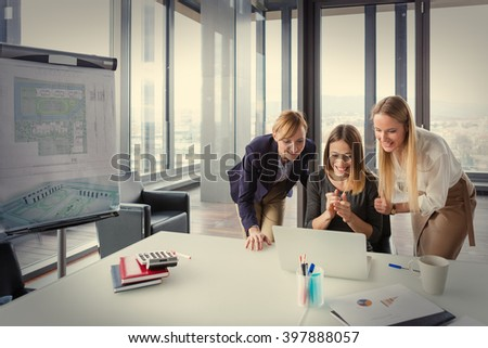 Three business women in modern office working on the project together. Post processed with vintage film filter. - stock photo