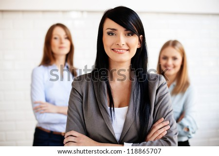 Three business women smiling. Selective focus - stock photo