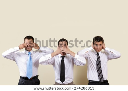 Three businessman covering eyes, mouth and ears - stock photo