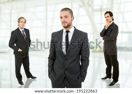 three businessmen at the office - stock photo