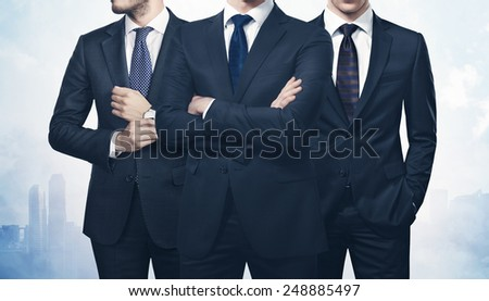 Three businessmen on megalopolis background - stock photo