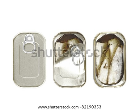 Three can of preserved sardines packed with virgin olive oil, in different stage of being pry open, isolated against white. - stock photo