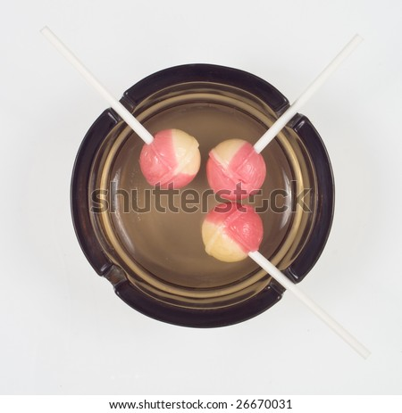three candies in ash pot - stock photo