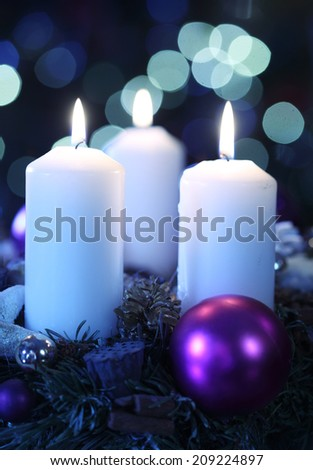 Three candles against abstract background - stock photo