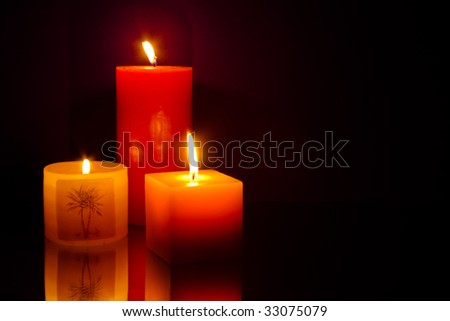 Three candles on blue background - stock photo
