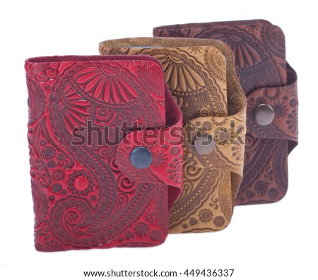 Three card holders isolated. Light brown business card holder, high quality leather, embossing, fastening the buttons, handmade. - stock photo