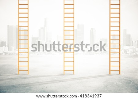 Three career ladders on concrete floor and misty city background - stock photo
