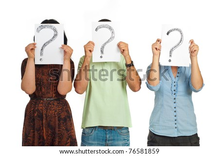 Three casual people standing in a line and holding questions marks isolated on white background - stock photo
