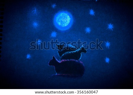three cats sleeping under the moon - stock photo