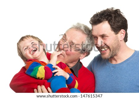 Three Caucasian male men of different generations: Grandpa, father and son. Studio shot isolated on white background. - stock photo