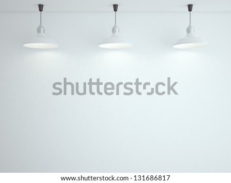 three ceiling lamps and white wall - stock photo