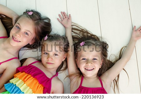 Three children closeup top view point - stock photo