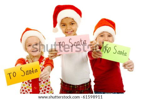 Three children holding their letters with note ?To Santa? - stock photo
