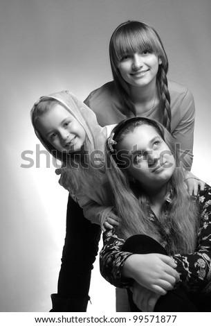 three children in a studio portrait shooting - stock photo