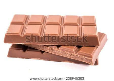 Three chocolate bars isolated on white - stock photo