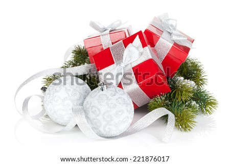 Three christmas gift boxes with baubles. Isolated on white background - stock photo
