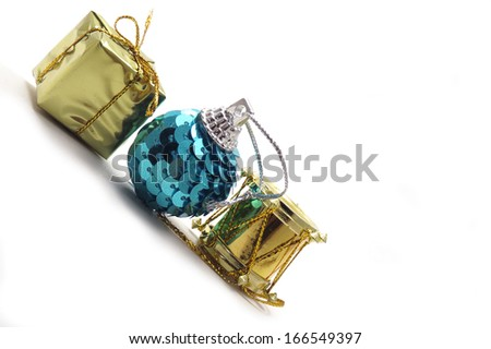 Three Christmas ornaments, gift, present, sequin ball, and drum - stock photo