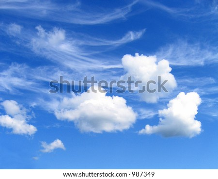Three clouds in a blue sky - stock photo