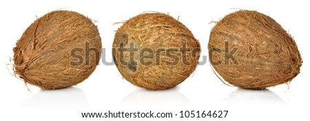 Three coconuts isolated on white background - stock photo