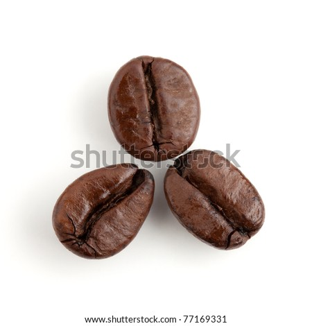 Three coffee beans. Isolated on white background - stock photo
