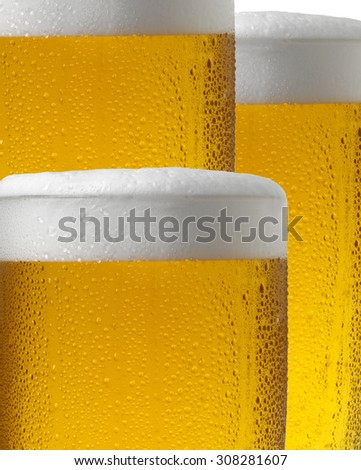 THREE COLD LAGER BEERS - stock photo