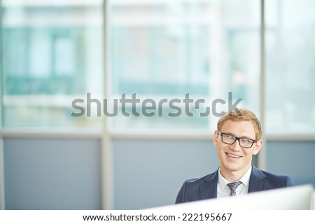 Three colleagues talking in office - stock photo