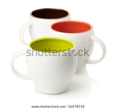 Three color coffee cups, isolated on white background - stock photo