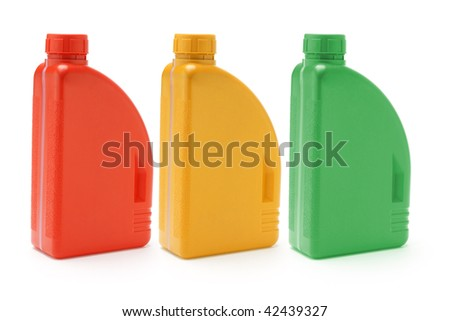 Three color containers of motor oil on white background - stock photo