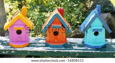 three colorful birdhouses - stock photo