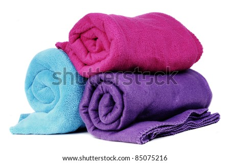 Three colorful fleece blankets - stock photo