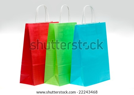 Three colorful paper shopping bags - stock photo