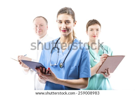 Three competent doctors ready to help - stock photo
