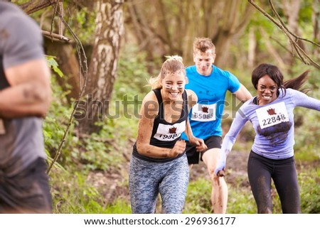 Three competitors running in a forest at an endurance event - stock photo