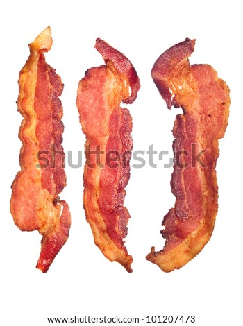Three cooked, crispy fried bacon isolated on a white background.  Good for many health and cooking inferences. - stock photo
