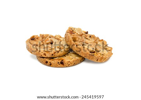 Three cookies with nuts and raisins isolated on white background - stock photo