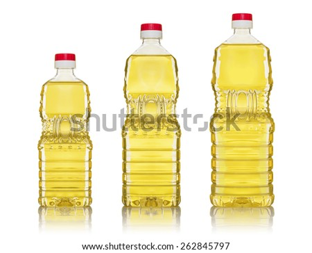Three Cooking Oil Bottles Isolated on Seamless White Background - stock photo