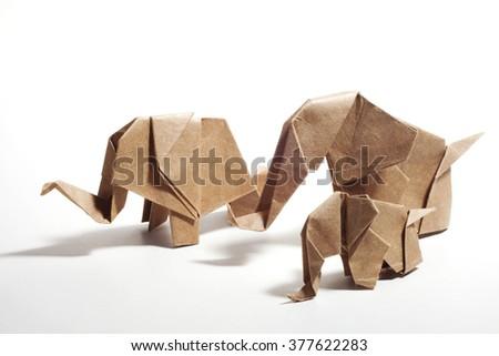 Three craft paper origami elephants family isolated on white background - stock photo